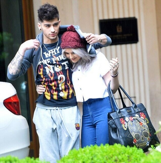 one direction,1d,1d munich germany 17.05.13,1d monaco germania 17.05.13, zayn malik, perrie edwards, zayn and perrie, zayn e perrie, zerrie, cute zerrie photo, zayn covering perrie with his jumper, zayn che copre perrie con la sua felpa
